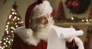 Santa Claus with checklist, portrait, close-up